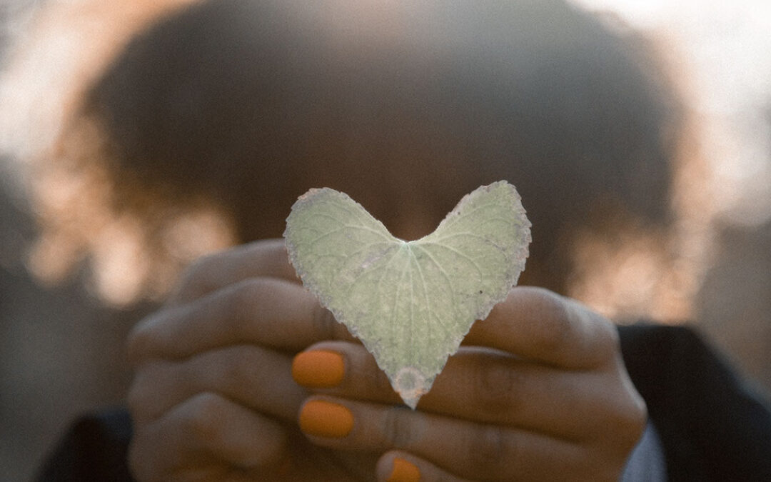 Be Kind To Yourself with Woman holding heart leaf