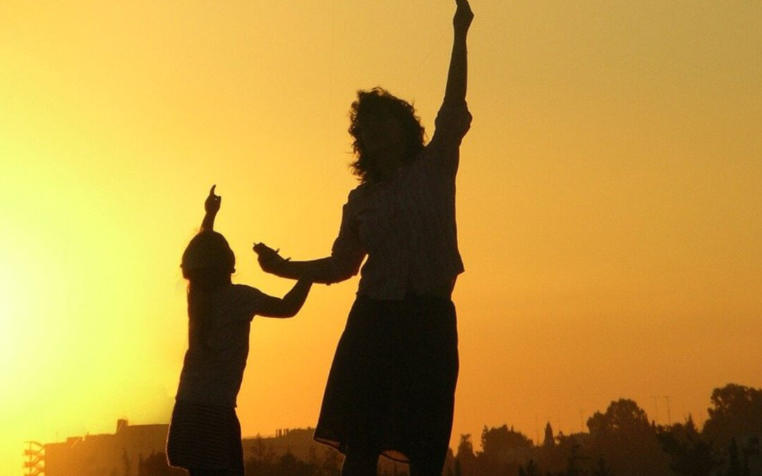 Mom and son pointing up at the sky