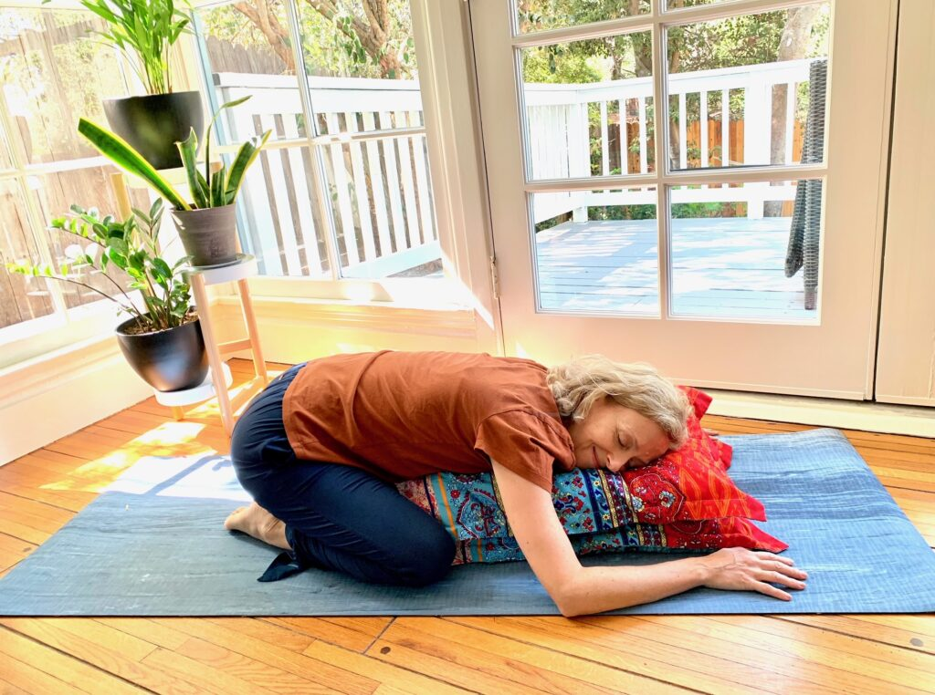Woman resting in child's pose