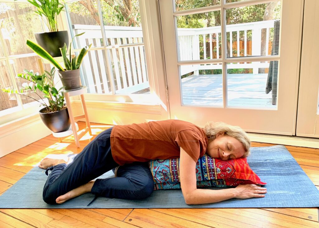 Woman lying in supported twist